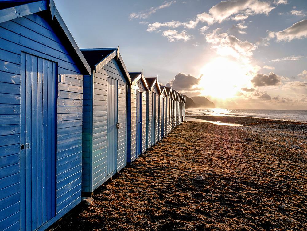 Charmouth beach huts at dawn